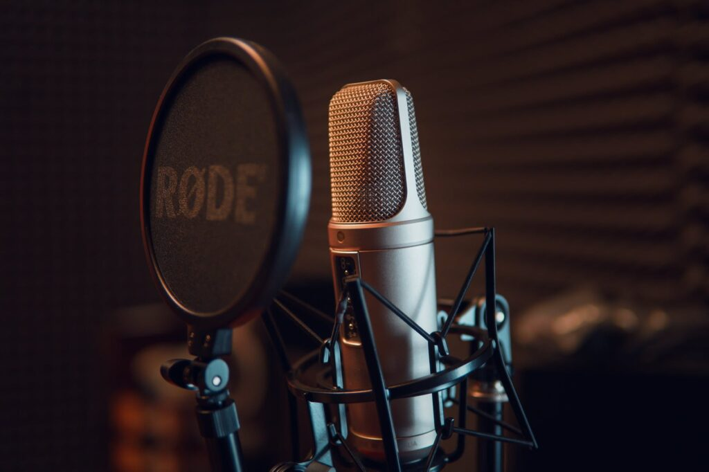 silver dynamic microphone on black microphone stand